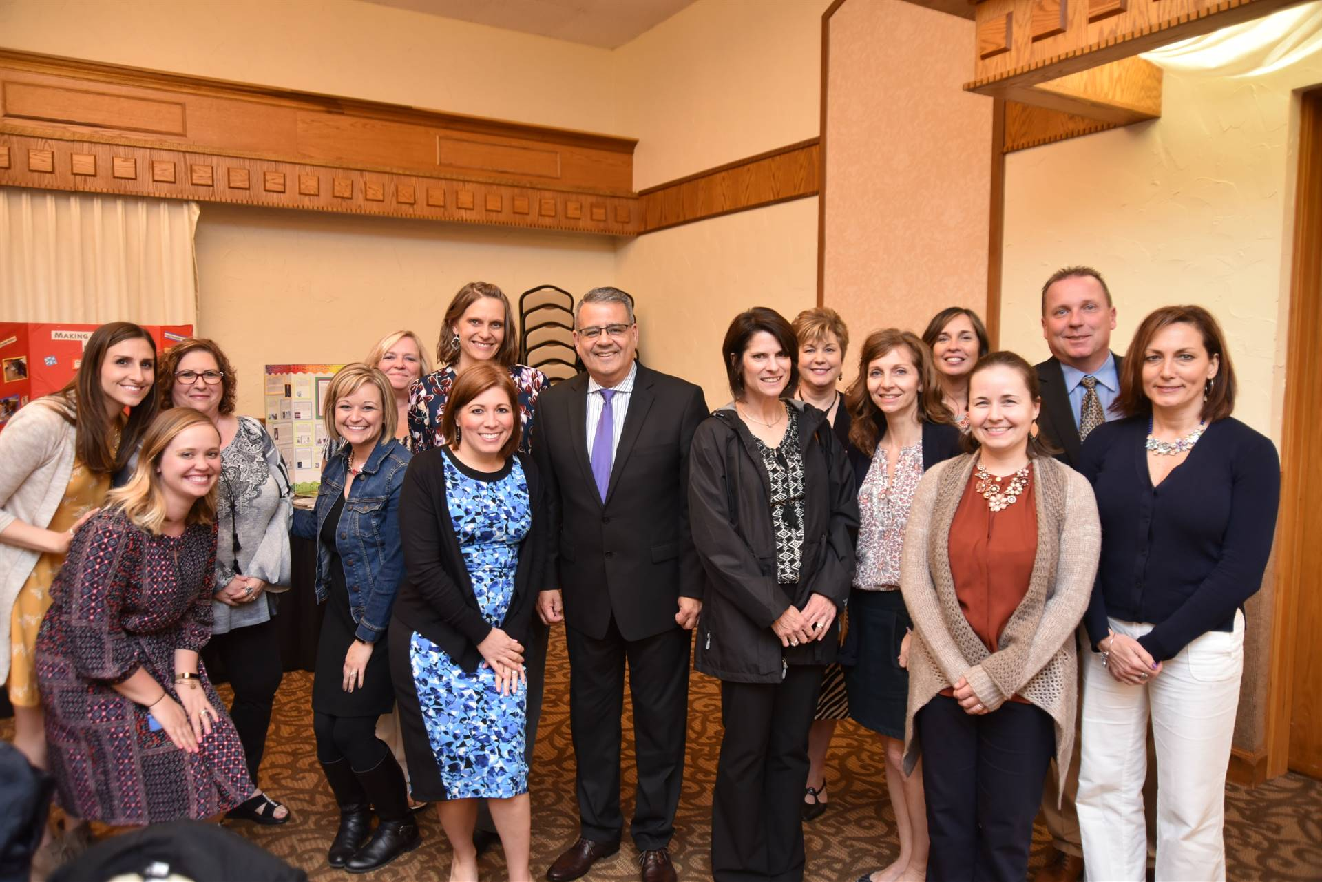ROyal View staff members surrounding Support Staff Person of the Year - Bob Rodriguez