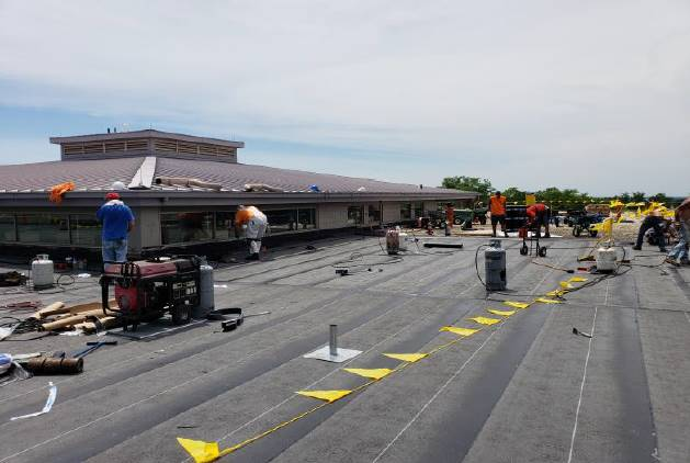 "NRMS Roof: Installation of mechanically-fastened 5/8"" Dens Deck Prime and vapor barrier -  June 2018"