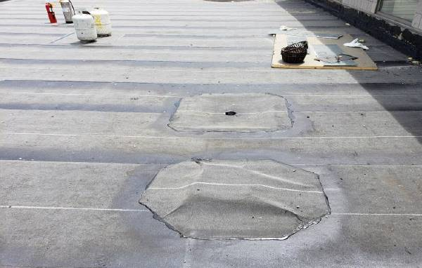 NRMS Roof: Installation of temporary cover of overflow drain - June 2018