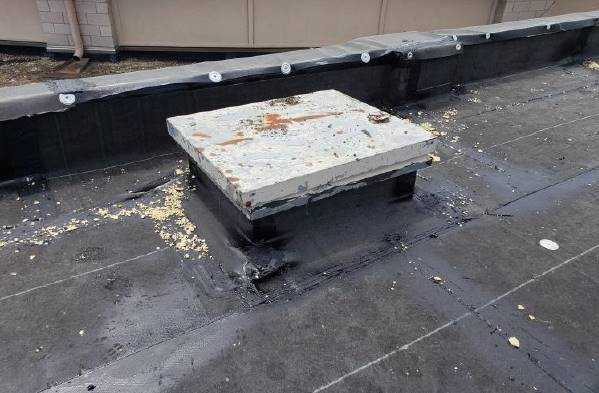 NRMS Roof: Existing roof hatch had to be replaced at the completion of the final roof installation -