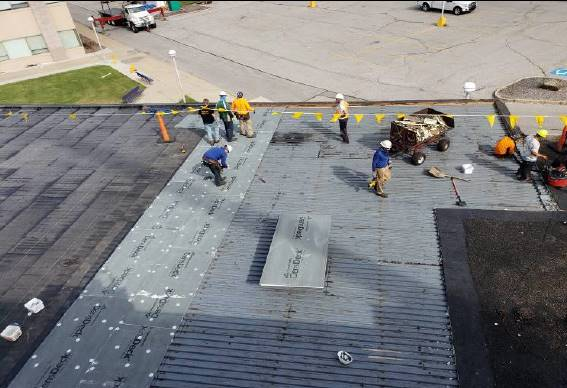 "Roof Section E: ARS crew removing existing roof system, installing 5/8"" mechanically fastened dens d"