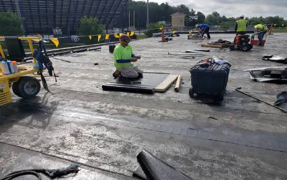 Roof Section F: ARS crew detailing installed modified bitumen base sheet installation.
