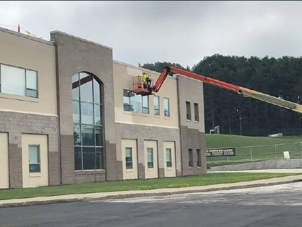 Photo 1: M-A is applying the base coat to the south elevation. July 24, 2018