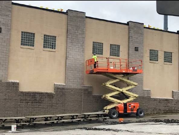 M-A is caulking the inside corners and CJ within the courtyard. July 24, 2018