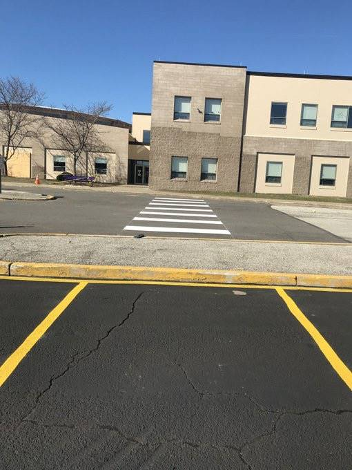 Parking lot restriped for new parking patterns as of April 1