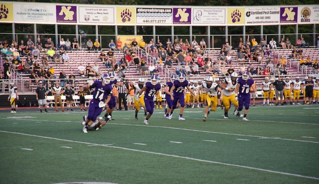 high school football team at homecoming game