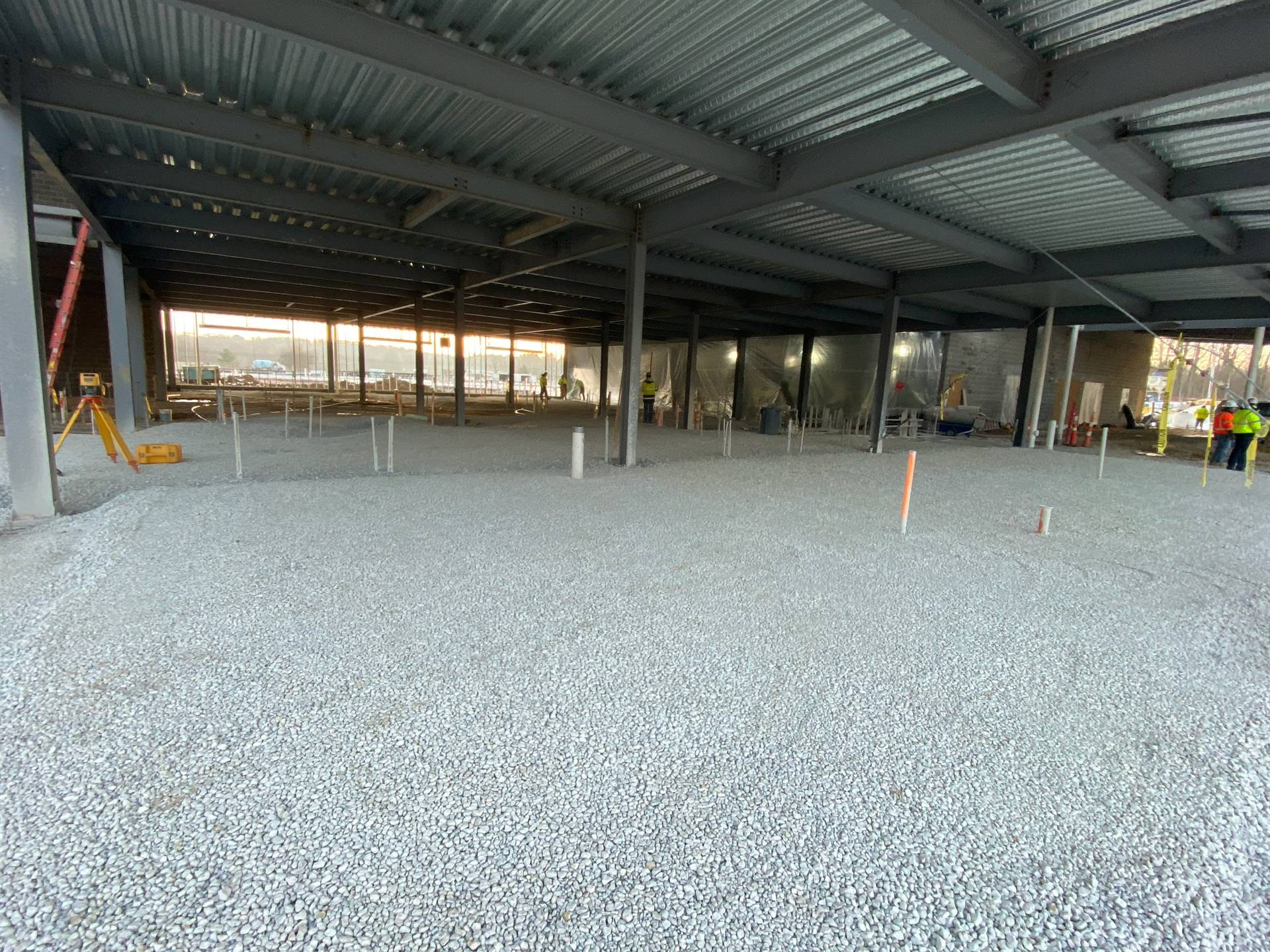 1st and 2nd grade areas stoned as well as gym. Once area is enclosed and heated it will be poured.