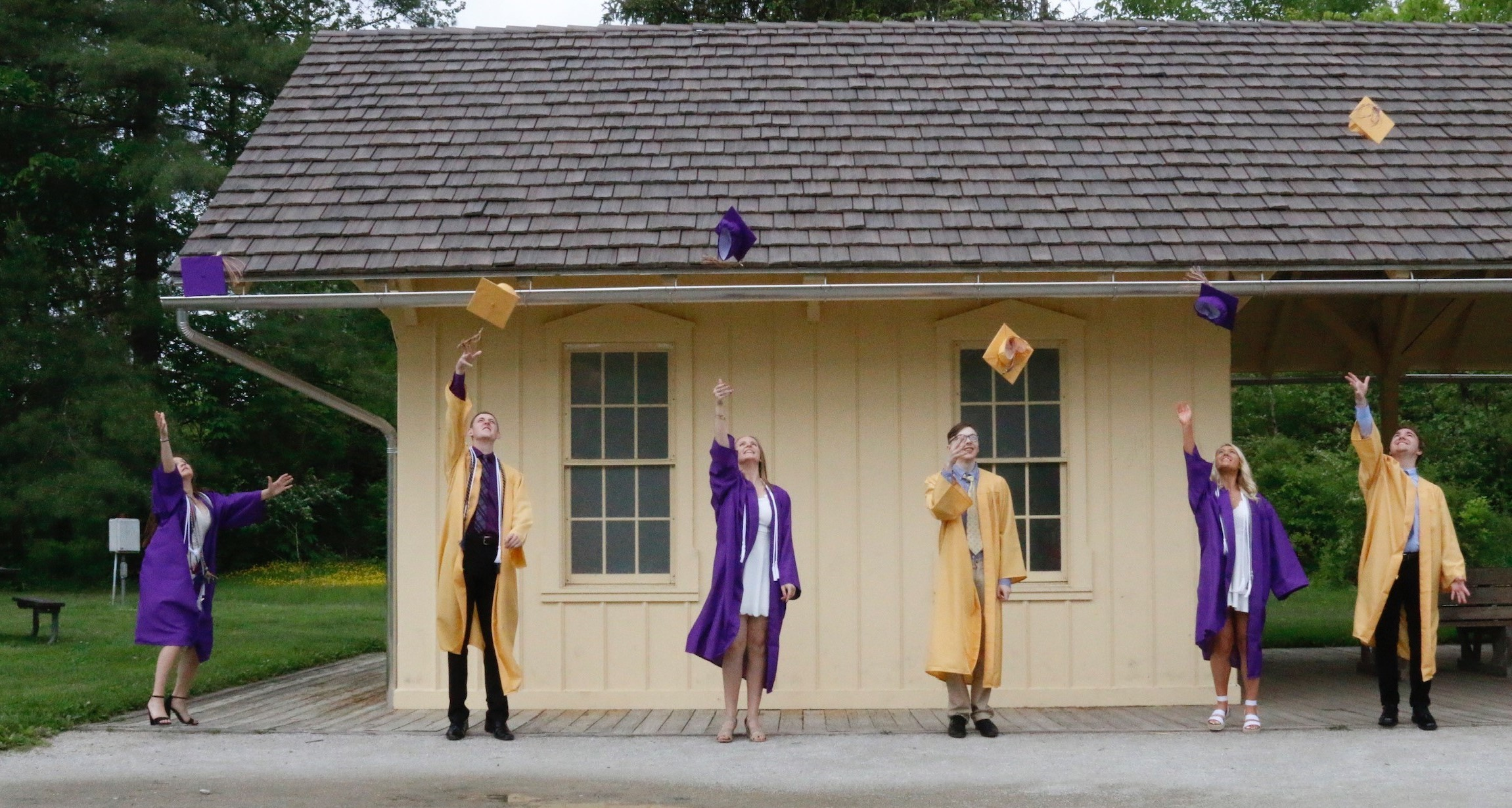 north royalton high school grads throwing caps in air