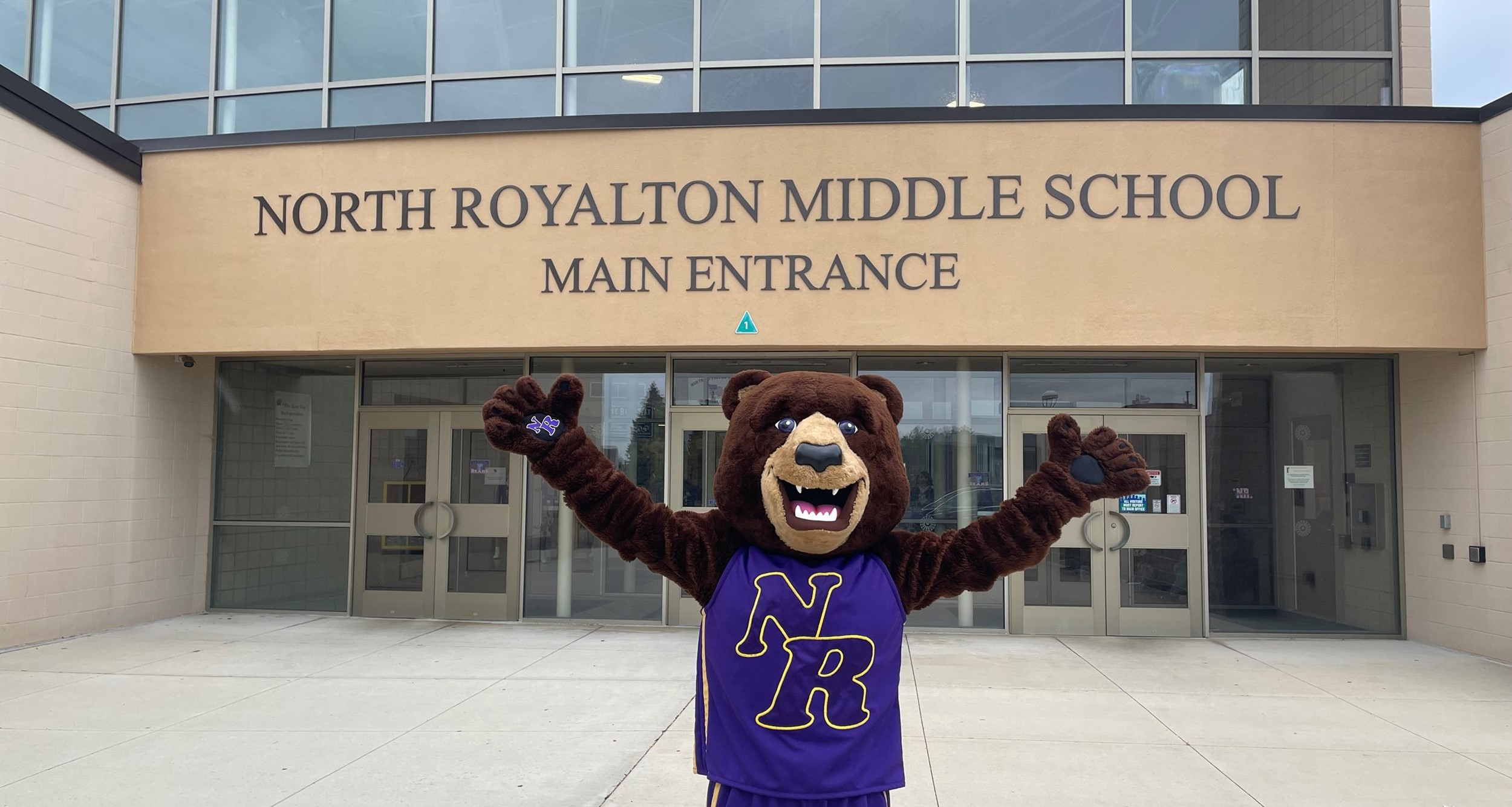 Gibby the mascot in front of North Royalton Middle School